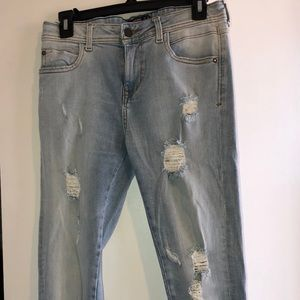 Light Wash Ripped and Fringe Jeans